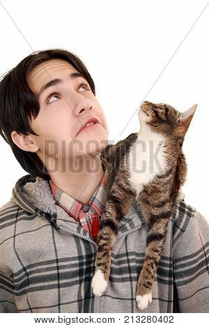 Common interest. Teen and pet sitting on his shoulder looking up