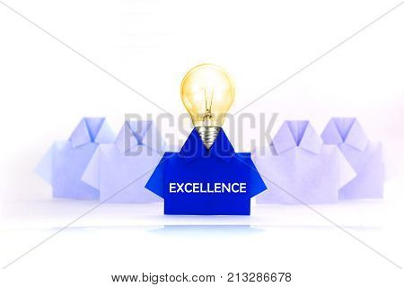 Light bulb in One blue among white origami shirt paper with EXCELLENCE word outstanding creative idea concept