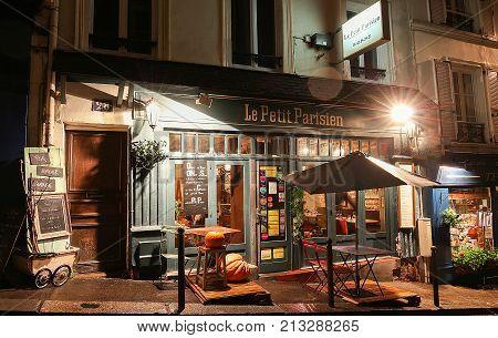 PARIS , France- November 11, 2017: View of typical paris cafe in Paris. Montmartre area is among most popular destinations in Paris, Le Petit Parisien is a typical cafe.