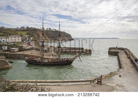 Charlestown, Cornwall, UK: April 13, 2016: The Phoenix set sail from Charlestown port on the south coast of Cornwall, England. She is a two masted Brig and was built in Frederikshavn, Denmark in 1929.