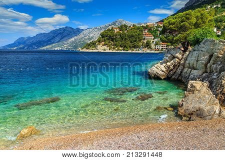 Stunning summer landscape with Adriatic Sea, Biokovo mountains and wonderful bay, Brela beach, Dalmatia, Croatia, Europe