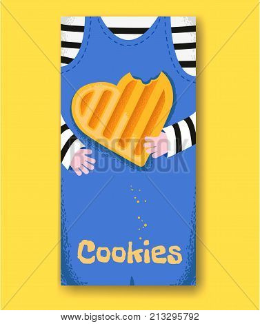 Baby hands hold bitten heart shape cookie. Boy in a striped blouse and denim overalls holding cookie