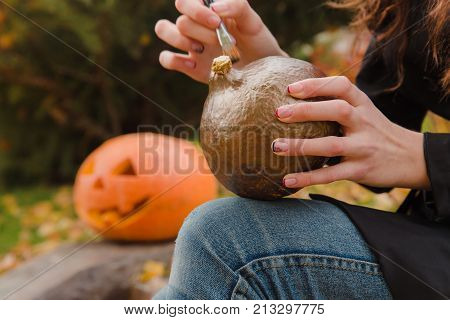 Woman's Hands Draws On Halloween Pumpkin