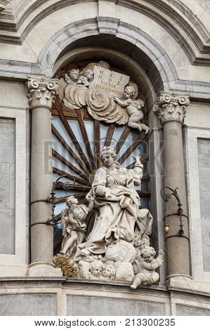 CATANIA, ITALY. April 2, 2015: Detail statue of Catania Cathedral dedicated to Saint Agatha. Roman Catholic cathedral in Catania, Sicily, southern Italy.