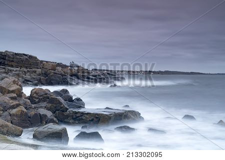 Rocky beach landscape at dusk. Kullaberg Sweden.