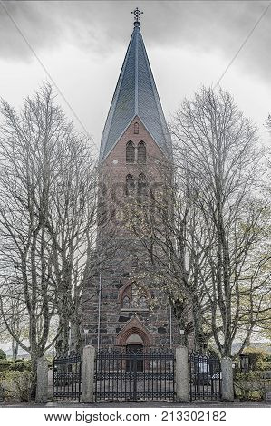 A spooky looking edit of vastra sonnarslovs church in the skane region of Sweden.