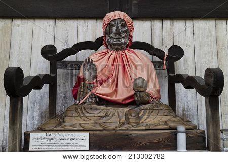 Nara, Japan -  May 29, 2017: Wooden statue of Binzuru or Pindola, one of the disciples of the Buddha, Todai-ji temple, Nara