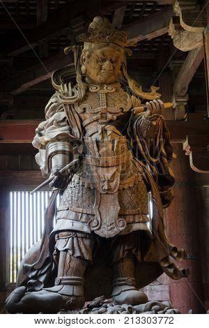Nara, Japan -  May 29, 2017: Wooden statue of  Komokuten guardian watching over Todaiji Temple and its precincts