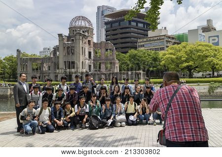 Hiroshima, Japan - May 25, 2017: Group of Students photographed in Peace Memorial Park, Hiroshima with the A-Bomb Dome in the background