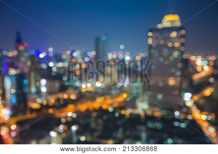 Night aerial view blurred bokeh city downtown skyline abstract background