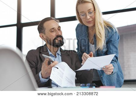 Handsome Bearded Experienced Man Checks Work Of Secretary Who Shows Documents. Account Manager And H