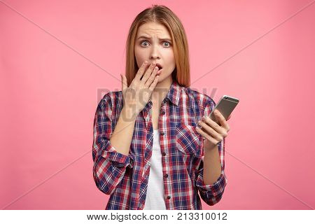 Shocked Female Model Holds Modern Mobile Phone, Missed Important Call From Partner, Being Puzzled. H
