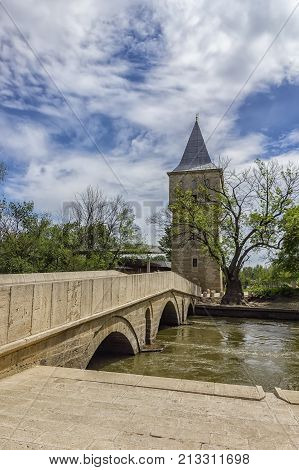 Court Tower of Justice and Sultan Suleyman bridge in Edirne city of Turkey.Freedom tower to kirkpinar using old stone bridge.