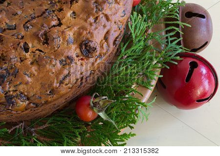 Traditional homemade fruitcake decorated with natural materials.