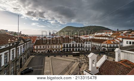Wide angle view of Angra do Heroismo downtown and Brazil mountain and the ocean in the background