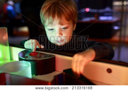 Boy Playing With Refraction Of Light