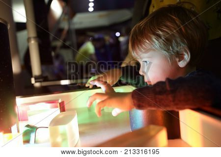 Boy Studying The Refraction Of Light