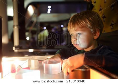Child Studying The Refraction Of Light