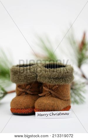 Merry Christmas card with mini felt boots and pine covered with snow flakes