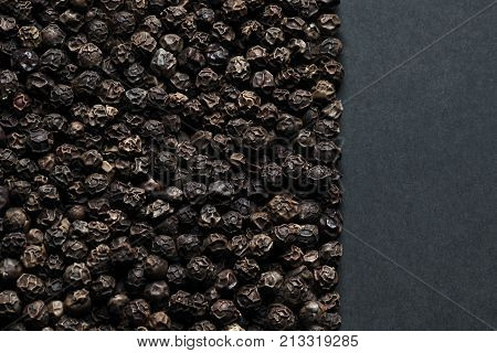 Black pepper peas from above, close-up. Laconic concept.