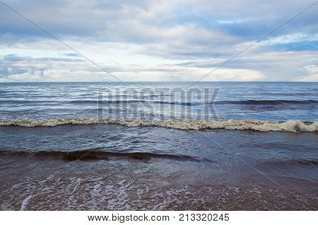 Landscape sea waves on background of cloudy -natural elements water Ocean waves. Wild sea storm - hazardous weather. The waves lapping on the shore.