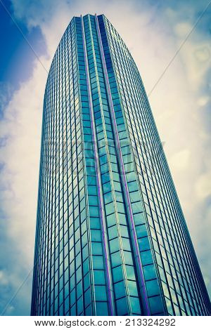 ROTTERDAM HOLLAND- AUGUST 23 2017; dramatic Instagram filter effect of lines and height of Modern architectural World Trade Center building with blue colored glass curtain wall and pink neon stripes