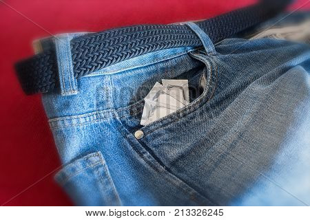 Condoms in the pocket of man's jeans