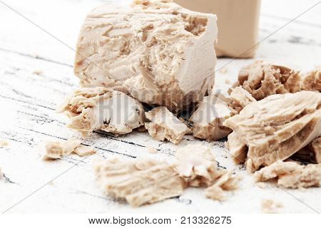 Dry yeast crumbled and yeast block for baking.