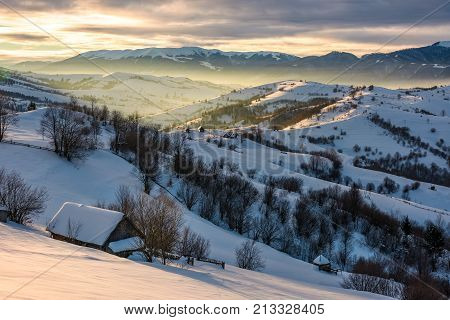 Village In Mountains On Winter Sunrise