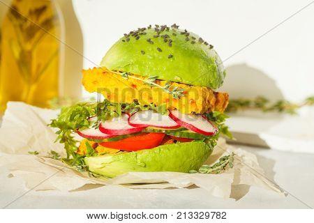 Vegan avocado lentils burger with vegetables and herbs. Healthy vegan food concept.