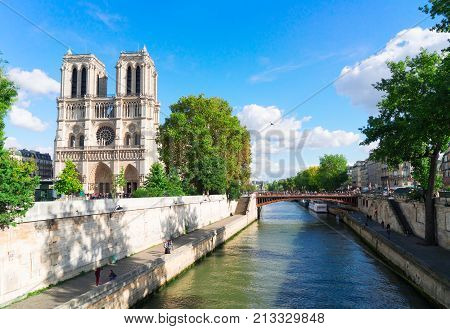 Notre Dame cathedral over the Seine river at sunny day, Paris, France
