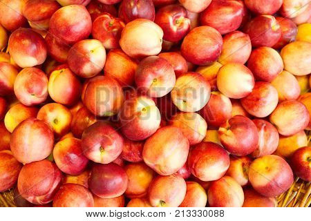 Nectarines in the store. A lot of nectarines close-up. Ripe nectarines. Selective focus