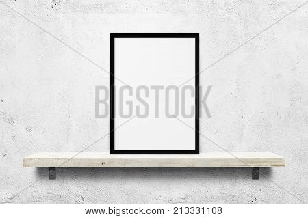 White blank photo frame mockup on shelf over white concrete wall background