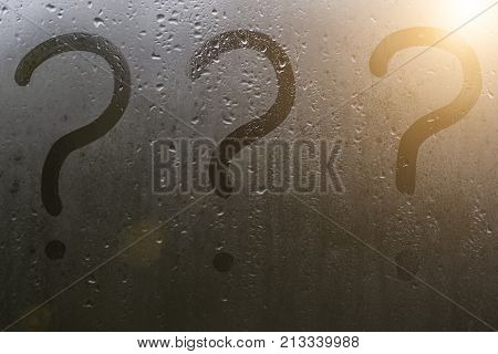 Question marks on the sweaty glass in the autumn