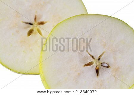 Nice background of cut fresh pear with seeds. Macro view of pear slice.