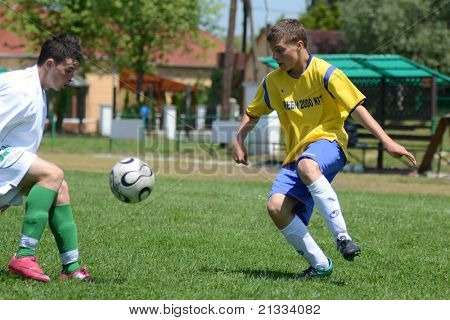 KAPOSVAR, HUNGARY - JUNE 11: Unidentified players in action at the Hungarian National Championship under 17 game between Kaposvari Rakoczi FC and Bajai LSE on June 11, 2011 in Kaposvar, Hungary.