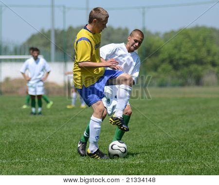 KAPOSVAR, HUNGARY - JUNE 11: Unidentified players in action at the Hungarian National Championship under 17 game between Kaposvari Rakoczi FC and Bajai LSE on June 11, 2011 in Kaposvar, Hungary.