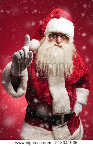 attention! santa claus is warning all the bad kids on red background