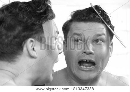 a man terrified of hairstyles . Photos in the studio