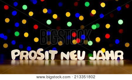 Prosit neu jahr happy new year in German language text beautiful multicolor bokeh background with copy space