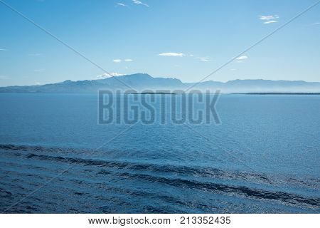 Morning mist over remote island landscape with the Pacific Ocean in Noumea, New Caledonia