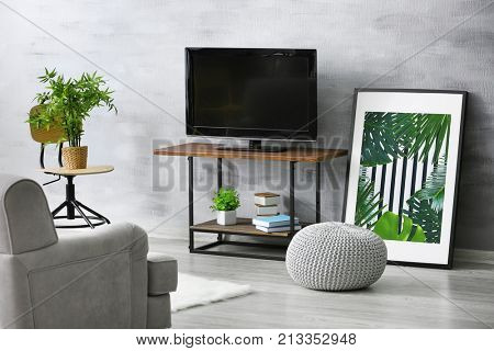 Modern TV set on stand in living room