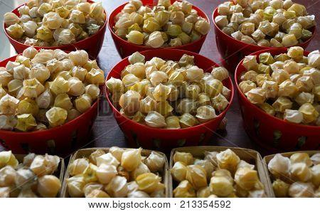 Bowls of cerises de terre (also called ground cherries)