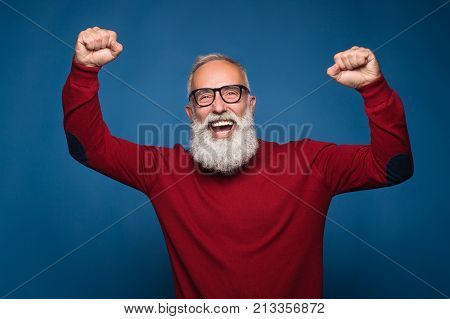 Happy for him favorite sport team. Real happy fan emotions celebrate a win of him team. Isolate on blue background.