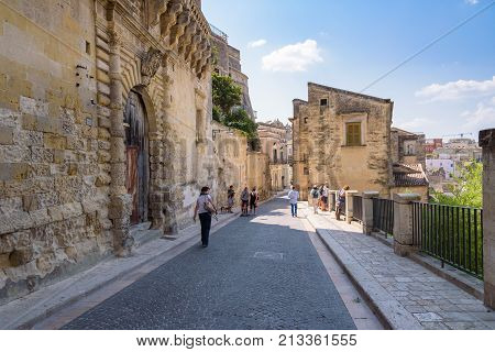 Matera Italy - September 2 2016: Tourists visit Via Duomo street leading to Piazza del Duomi in Matera.
