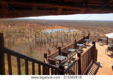 Panoramic View Of African Savannah And Watering Hole: Victoria Falls Safari Lodge, Zimbabwe October 2015
