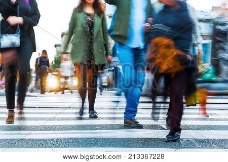 Crowds Of People In Motion Blur Crossing A City Street