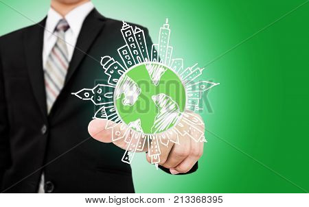 Businessman pointing on doodle globe with buildings. Eco-friendly business, Green business, environmental reservation and sustainable business concept