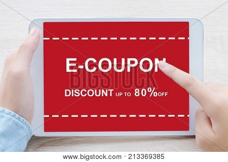 E-coupon discount coupon on tablet screen to get the shopping on line promotion on line shopping digital marketing business and technology lifestyle concept
