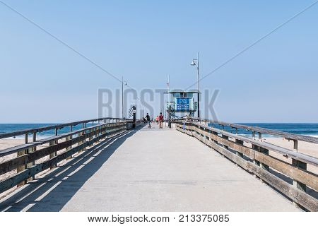 SEPTEMBER 8, 2017 - VENICE, CALIFORNIA:  A skateboarder and other visitors enjoy the Southern California weather on the Venice Beach fishing pier in Los Angeles County.